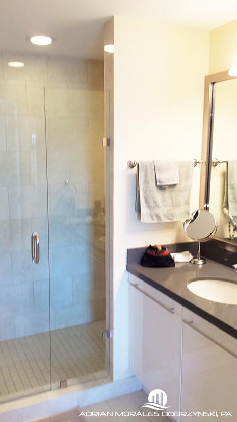 Shower with glass door at Ivy condos