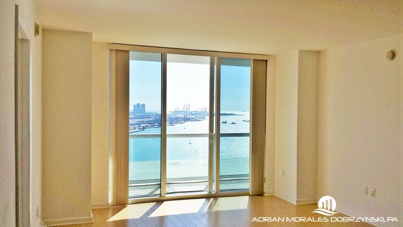 Bay and ocean views from this living room at 50 Biscayne