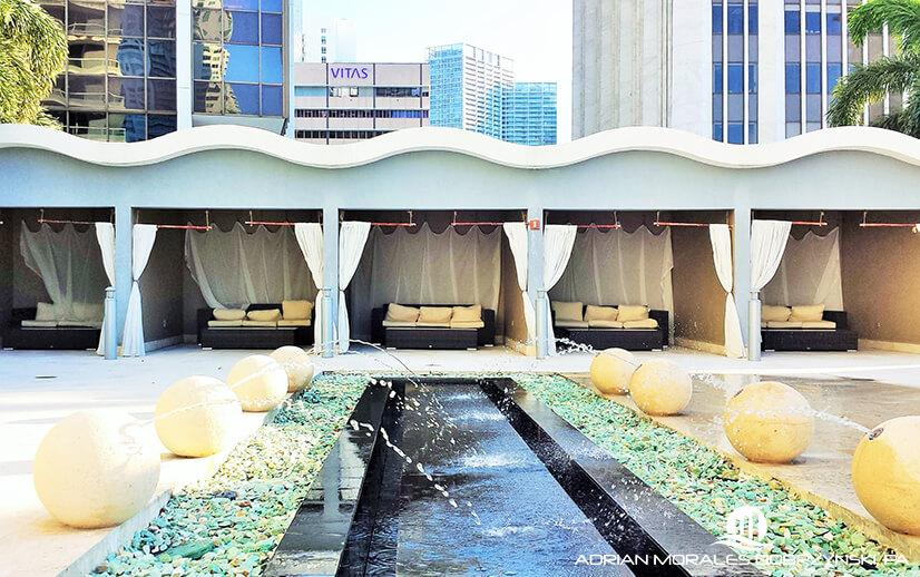 Poolside cabanas and amenities at 50 Biscayne condominiums