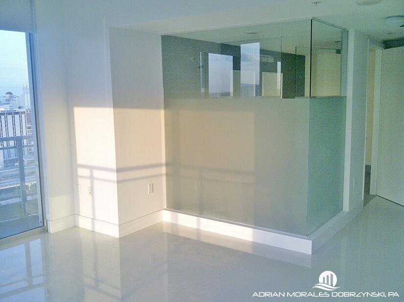 Glass shower in master bedroom at Mint condominium