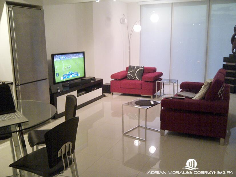 Furnished living room of a one bedroom at Mint